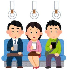 電車でスマホを見る人々のイラスト